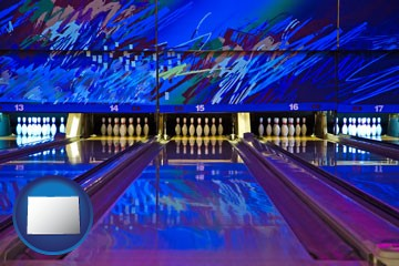 a bowling alley with an abstract wall mural - with Colorado icon