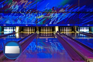 a bowling alley with an abstract wall mural - with Kansas icon