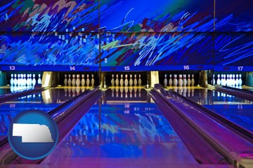 a bowling alley with an abstract wall mural - with Nebraska icon